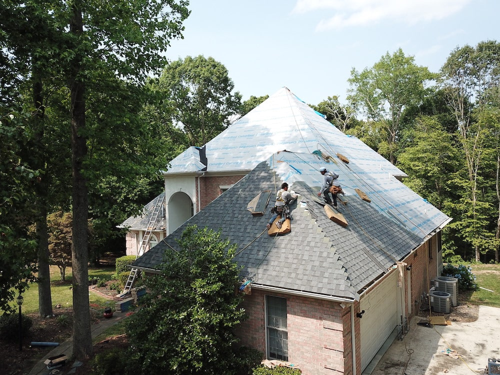 A roof being reshingled by our roofing contractor in Greensboro, NC